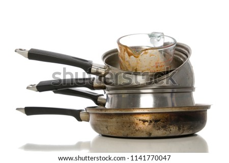 Dirty pots and pans piled up for washing. #1141770047