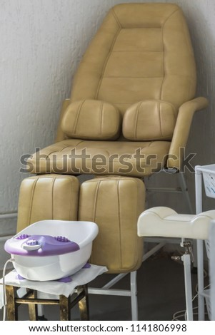 Convenient leather chair for the client on services of a pedicure from a bathroom for legs #1141806998