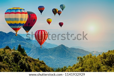 Beautiful view of mountain with hot air balloons on morning at Thailand. #1141932929