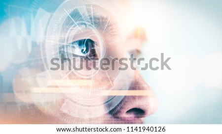 The double exposure image of the businessman looking up during sunrise overlay with cityscape image and futuristic hologram. The concept of modern life, technology, iris scanner and internet of things #1141940126