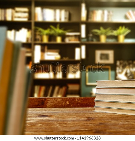 Desk of free space and school time. Blurred background of books and furniture.  #1141966328