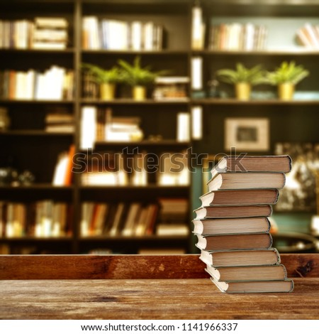 Desk of free space and school time. Blurred background of books and furniture.  #1141966337