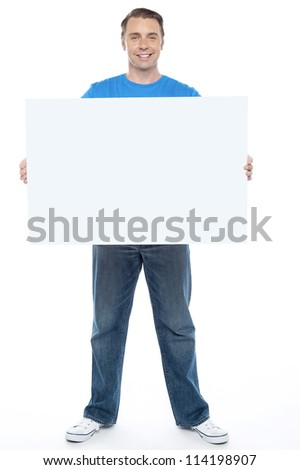 Handsome casual guy holding blank ad board, full length shot #114198907