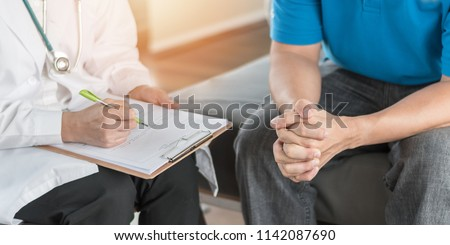 Male patient having consultation with doctor or psychiatrist who working on diagnostic examination on men's health disease or mental illness in medical clinic or hospital mental health service center #1142087690