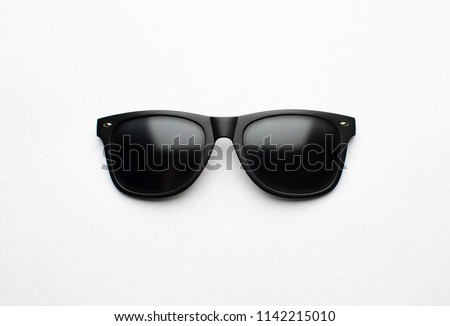 Vintage sunglasses with black plastic frame on white background Royalty-Free Stock Photo #1142215010