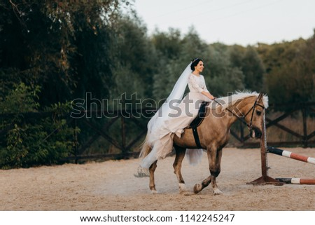 Beautiful bride rides on the horse  #1142245247