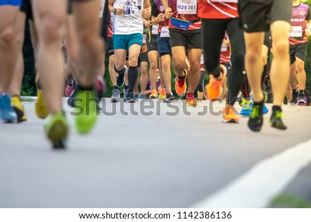 Chiang Mai, Thailand - June 17th, 2018 : Group of Chiang Mai people feet running in marathon running race on June 17th, 2018 in Chiang Mai Thailand #1142386136