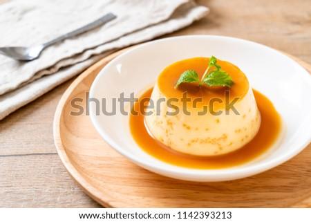 homemade caramel custard pudding with mint #1142393213