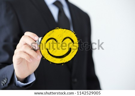Businessman is writing the Positive Smile Face Business Concept. #1142529005
