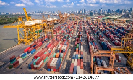Logistics and transportation of Container Cargo ship and Cargo plane with working crane bridge in shipyard at sunrise, logistic import export and transport industry background #1142614697