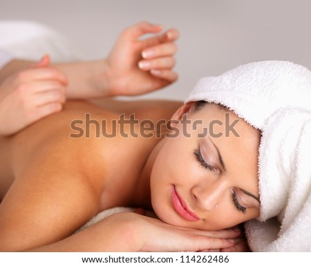 Closeup of an attractive young woman receiving massage #114262486