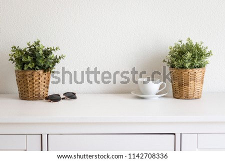 desk table with sunglasses and cup #1142708336