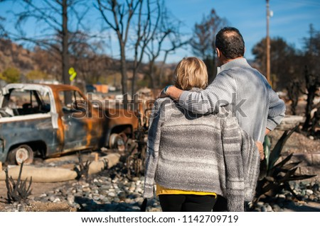 Man and his wife owners, checking burned and ruined of their house and yard after fire, consequences of fire disaster accident. Ruins after fire disaster. #1142709719