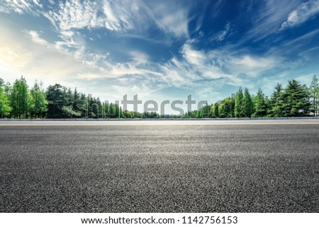 Asphalt road and green forest landscape under the blue sky #1142756153