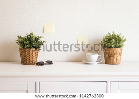 cup, sunglasses and plants on white table in business office, st #1142762300