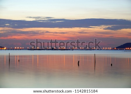 Long exposure shot of Lake view at Southern Thailand on sunset time background,Long exposure shot lake view with colored sky over lake on sunset time background.