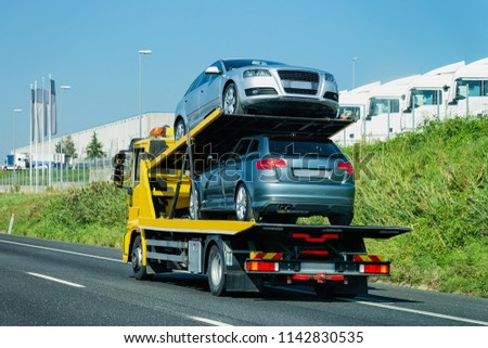 Cars carrier on the road. Truck transporter #1142830535