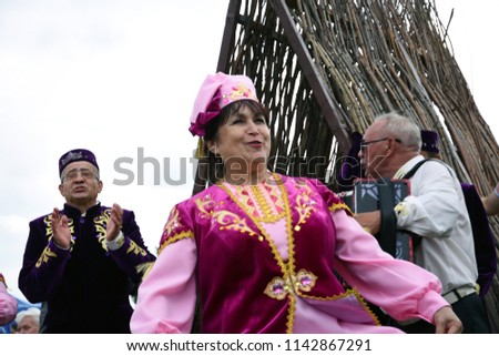 MOSCOW - JULY 21, 2018: People celebrate Sabantui in Moscow. Free entrance public event. Sabantui is a national Bashkir and Tatar holiday, end of field works. #1142867291