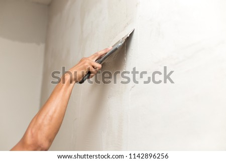 The process of applying the second layer of putty trowel for light plaster walls #1142896256