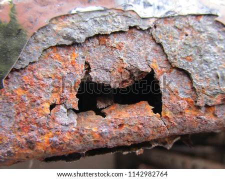 Corrosion hole on car body panel #1142982764