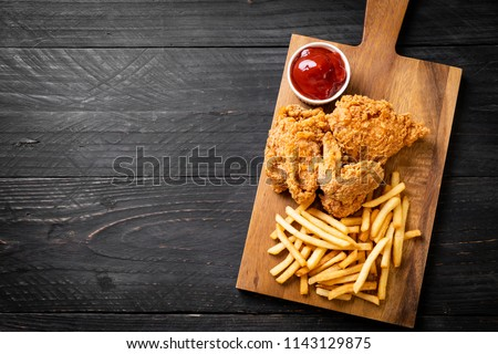 fried chicken with french fries and nuggets meal - junk food and unhealthy food #1143129875