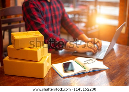 Online shopping young start small business in a cardboard box at work. The seller prepares the delivery box for the customer, online sales, or ecommerce. #1143152288