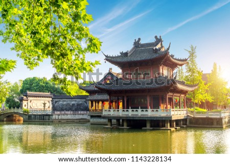 Chinese traditional classical architecture by the lake #1143228134