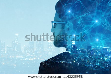 Side portrait of handsome young businessman on abstract night city background with copy space and polygonal network. Double exposure
