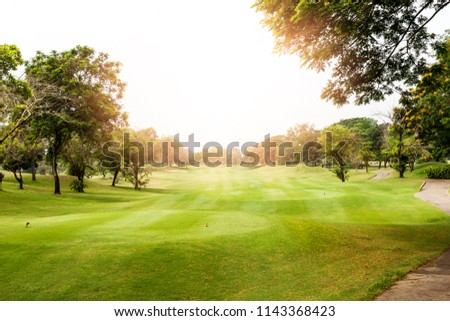 Beautiful landscape of golf course in the countryside in sunset, sunrise time. Asia, Thailand. #1143368423