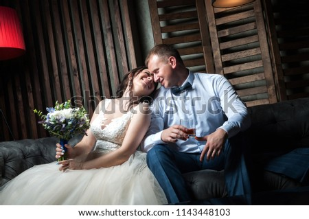 Young couple of the bride and groom in a beautiful interior room #1143448103