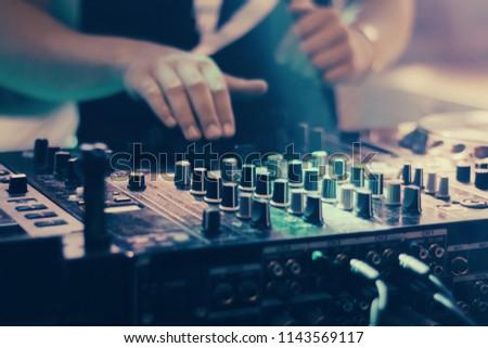 DJ playing music at mixer closeup #1143569117