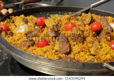 Uzbek pilaf with meat, garlic and tomatoes  #1143590294