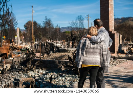 Man and his wife owners, checking burned and ruined of their house and yard after fire, consequences of fire disaster accident. Ruins after fire disaster. #1143859865