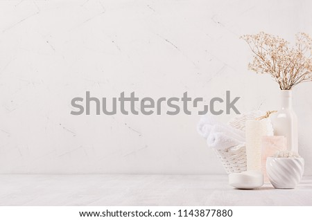 Elegance light soft white homemade cosmetics set of products for body care and bath accessories with white dry flowers in light soft interior, copy space. #1143877880