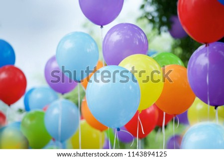 Balloons of different colors filled with helium as a decoration on a children's holiday or birthday.