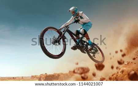 Cyclist riding a bicycle. Downhill. #1144021007