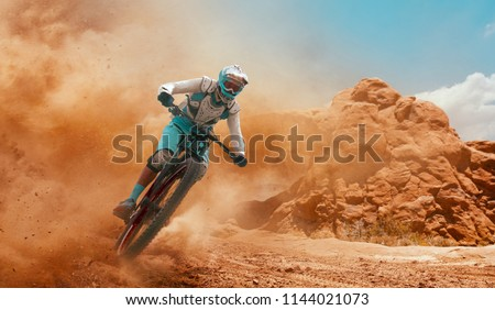 Cyclist riding a bicycle. Downhill. #1144021073