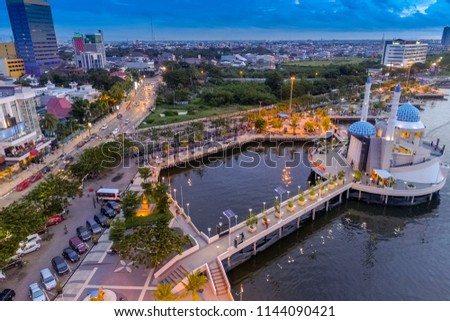 Makassar, South Sulawesi / Indonesia - Jan 23, 2017: Aerial View of Amirul Mukminin Floating Mosque, An Icon in Losari Beach #1144090421