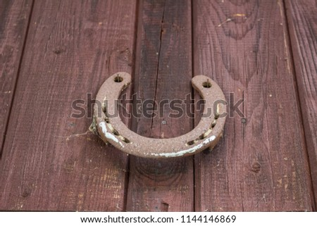 Horseshoe for luck on the wall #1144146869