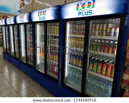 Bandar Bukit Tinggi, Malaysia - 22 July 2018 : Supermarket aisle with refrigerated shelves.The shelves are equipped with glass doors and colorful products inside.   #1144288958