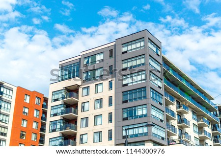 Modern condo buildings with huge windows in Montreal, Canada.  #1144300976