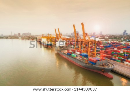 Aerial view of ship containers at shipping port for international import or export logistics or transportation business concept background. #1144309037