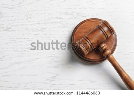 Judge's gavel on light background, top view. Law concept #1144466060