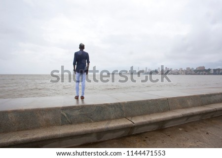MUMBAI, INDIA - JULY 2 2018: Unidentified people visit promenade in South Mumbai.  The promenade is an open space where people could meet friends and just spend time #1144471553