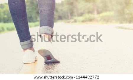 women walking on street in the morning #1144492772