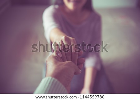 Men giving hand to depressed woman,Husband support and encourage wife,All hands in women above,Psychiatrist holding hands patient,Mental health care concept #1144559780