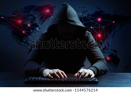 Hacker using keyboard and world map on background. Threat of global cyber attack