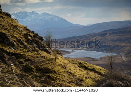 Landscape shot high above the mountain ranges in Isle of Skye, Scotland during the day.  #1144591820