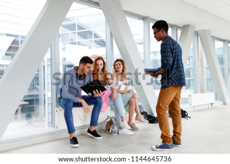 A group of young students from different countries communicate at the University. The photo illustrates education, College, school, or University. #1144645736