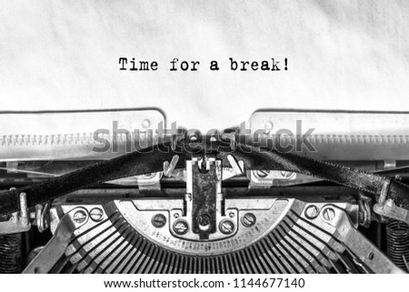 Time for a break, typed text on an old typewriter, close-up, ink on paper #1144677140